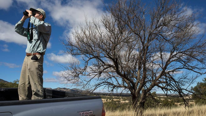 Scott Wilbor of the Sky Island Alliance, watching a wildlife corridor near Lochiel, Arizona,  says the nearby Patagonia Mountains would be suitable jaguar habitat.