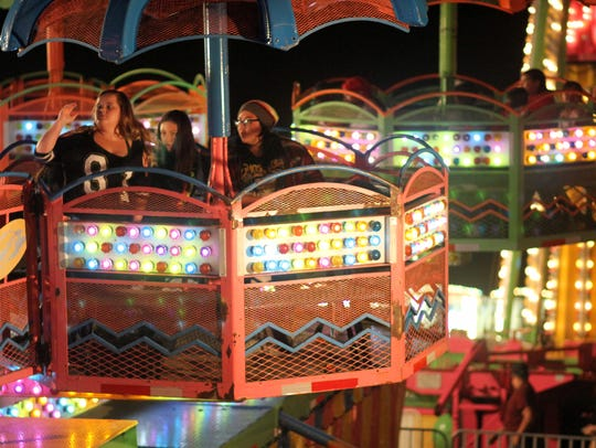 The carnival midway came alive at night with the flashing