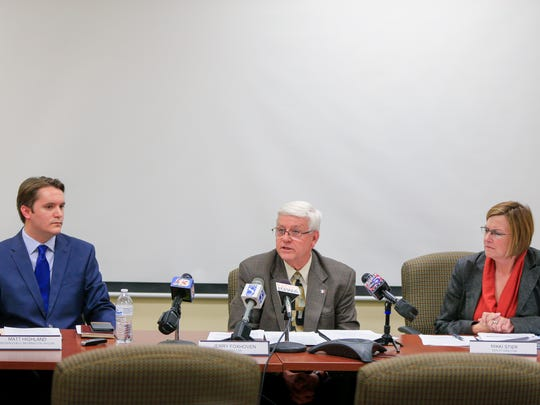 DHS spokesman Matt Highland, DHS Director Jerry Foxhoven and DHS Deputy Director Mikki Stier announce that AmeriHealth Caritas will pull out of Iowa Medicaid management during a press conference Tuesday, Oct. 31, 2017.