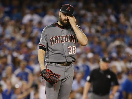 Robbie Ray reacts after allowing Dodgers base runner Logan Forsythe to score on a wild pitch in the fourth inning on Saturday.