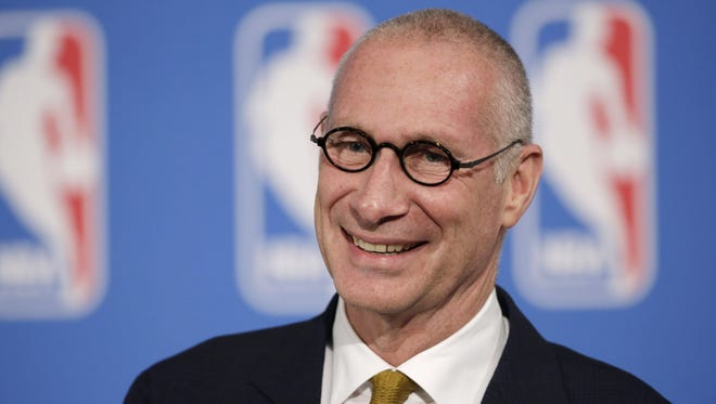 """FILE - In this Oct. 6, 2014, file photo, ESPN President John Skipper smiles during a news conference in New York. Disney's ESPN on Wednesday, Oct. 21, 2015 confirmed it is cutting about 300 jobs, or 4 percent of its staff, amid signs that the traditional cable bundle is less far-reaching than it once was. Skipper says, in a memo to employees that was posted online, these cuts are part of changes being made to keep ESPN as the """"premier sports destination on any platform."""" (AP Photo/Mark Lennihan, File) ORG XMIT: NYBZ176"""