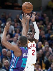 Indiana Pacers guard Darren Collison (2) shoots a three-pinter over Charlotte Hornets guard Kemba Walker (15) in the first half of their game at Bankers Life Fieldhouse on Tuesday, April 10, 2018.