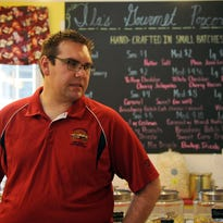 Jared Eschbaugh, owner of IlaÕs Gourmet Popcorn, talks about the variety of flavors offered at the Granville store. Many of the favors are inspired by candy recipes from his grandmother, Ila.