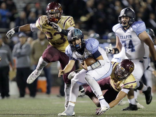 Chapin quarterback Anthony Baird is tackled by Andress