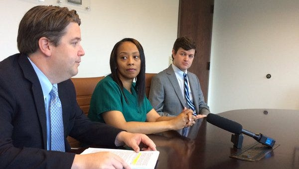 Lawyer Jerry Martin, left, with client Tonya Bowers, middle, a plaintiff in a lawsuit against ITT Technical Institute