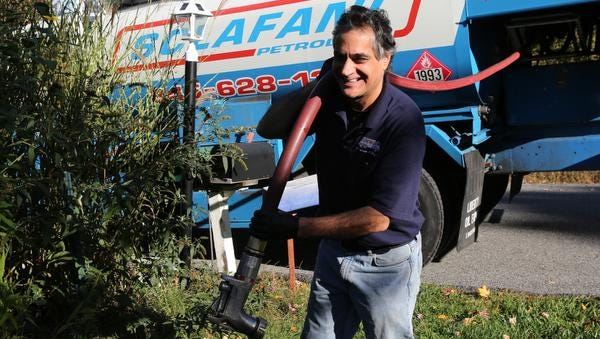 Mike Rosa of Scalfani Oil, makes a delivery of home heating oil to a client in Kent Oct. 9, 2014 .