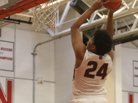 Ronald harper of Don Bosco does a reverse dunk in the