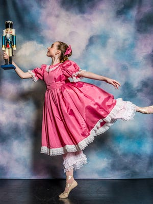 Clara, danced by Joely Gipe, and her Nutcracker doll.