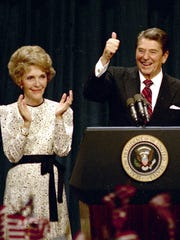 ** FILE ** President Ronald Reagan gives a thumbs-up