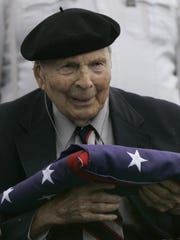 In a May 26, 2008 file photo Frank Buckles receives an American flag during Memorial Day activities at the National World War I Museum in Kansas City, Mo. Buckles died early Sunday, Feb. 27, 2011 of natural causes in his home in Charles Town, W.Va.