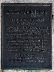 The plaque on the statue of Dr. James Marion Sims in