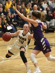 Southeast Polk freshman Grace Larkins tries to get