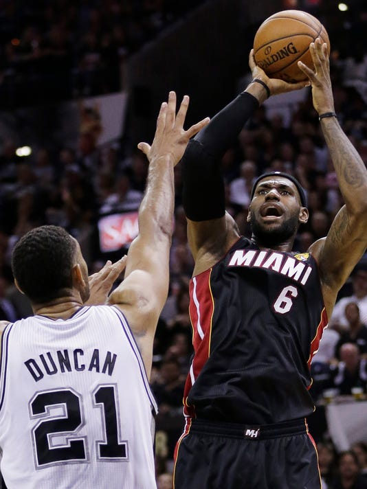 Miami Heat forward LeBron James (6) shoots over San Antonio Spurs forward Tim Duncan (21) during the first half in Game 2 of the NBA basketball finals on Sunday, June 8, 2014, in San Antonio. (AP Photo/Eric Gay)
