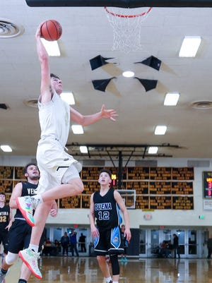 East All-Star Riley Battin goes in for a dunk during the Ventura County Coaches Association All-Star Boys Basketball game Friday night at Ventura High. The Oak Park star was named the game's MVP after scoring 41 points to lead the East to a 130-86 victory.
