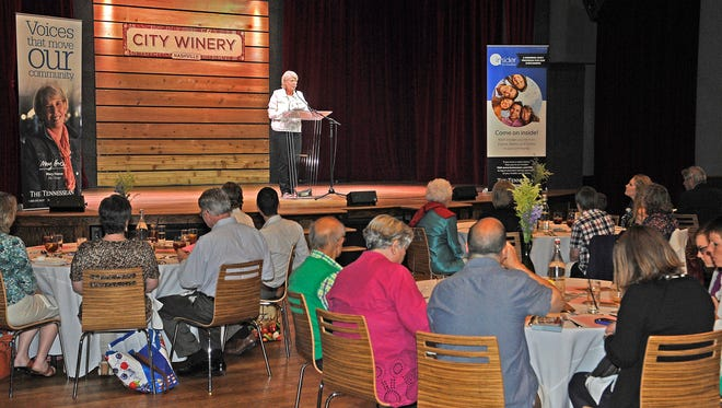 Mary Hance speaks to the winners of the cheapest of the cheap contest at The City Winery.  Saturday May 16, 2015, in Nashville, TN
