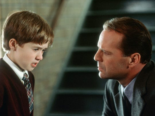 "Eight-year-old Haley Joel Osment with Bruce Willis in 1999's ""The Sixth Sense."""
