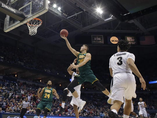 Vermont forward Payton Henson (35) shoots during their first round game of the NCAA Division I Men's Basketball Tournament game against Purdue Thursday, March 16, 2017 at the BMO Harris Bradley Center in Milwaukee.