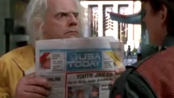 "Christopher Lloyd's character displays a future version of USA TODAY in one of the movies from the ""Back to the Future"" series."