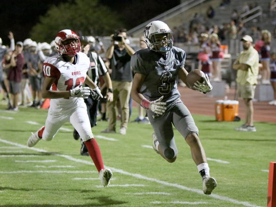 Rancho Mirage's Jevin Dorsey scores a touchdown during