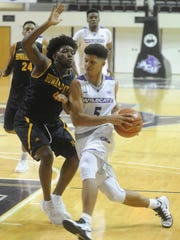 ACU's Payten Ricks (5) drives against a Howard Payne defender. ACU beat the Yellow Jackets 71-55 Sunday, Nov. 27, 2016 at Moody Coliseum.