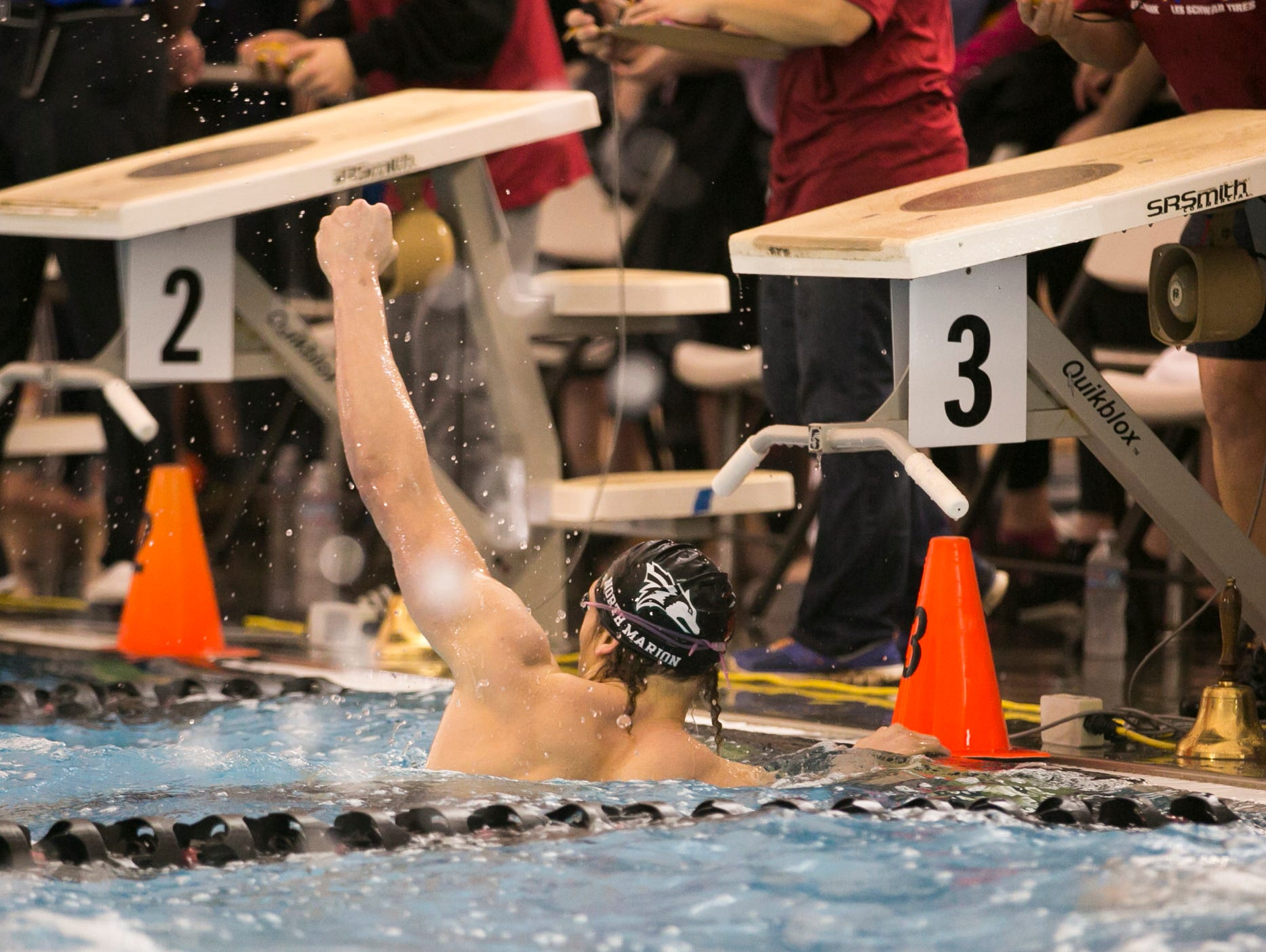 North Marion's Noah Norris pumps his fist in the air after swimming the boys 100 yard freestyle at the OSAA Swimming State Championships at Mount Hood Community College on Saturday, Feb. 20, 2016.