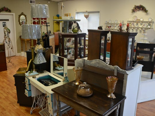Some of the vintage furniture on the sales floor at