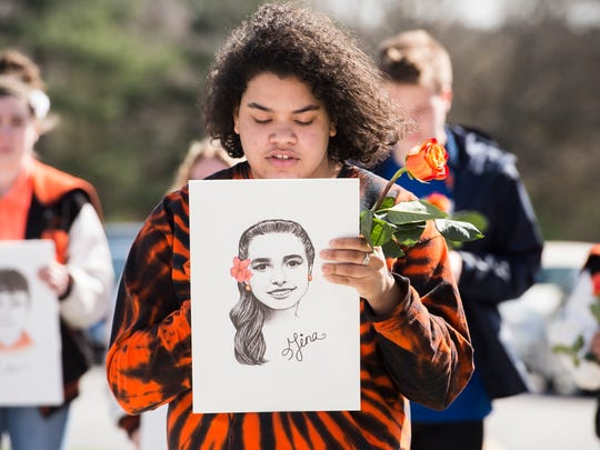 Alexis Faisal reads the biography of Gina Montalto, a 14-year-old student and marching band guard member who was one of 17 people killed in the Parkland school shooting in February. Faisal was joined by dozens of other students who were participating in the National School Walkout Friday, April 20, 2018.
