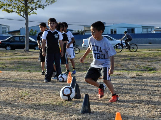 The César Chávez Futbol Academy's beginnings started in 2010 when a group of kids came to the César Chávez Library sporting cleats and soccer jerseys to watch the World Cup.