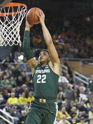 Michigan State forward Miles Bridges scores against Michigan during the first half Tuesday, Feb. 7, 2017 at Crisler Center.