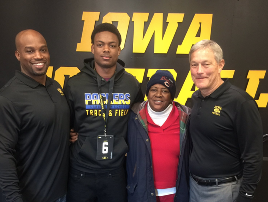 Iowa recruit Calvin Lockett poses with his family and
