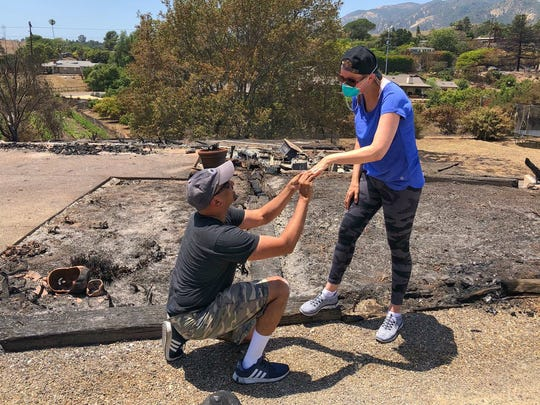 After finding her wedding ring in the ashes of their Goleta home destroyed by the Holiday Fire Sunday, Ishu Rao asked his wife Laura Rao to marry him again.