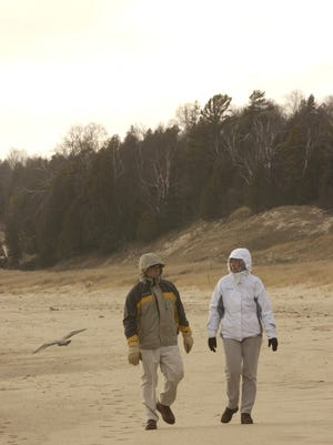 Dan Palmer, left, and his wife, Barbara, of Shawno, took advantage of ThursdayÕs milder weather, January 1, 2004, to hike the trails of Whitefish Dunes State Park in Door County in 2004.