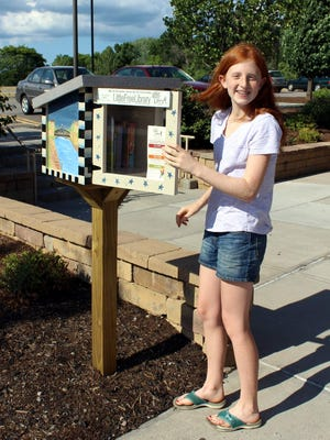 Fairport eighth-grader Jess Suiter erected a Little Free Library at the Perinton Community Center for her Girl Scout Silver Award project.