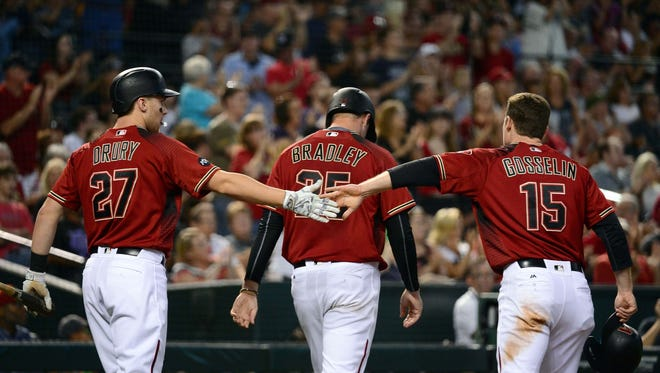 May 29, 2016: Arizona Diamondbacks outfielder Brandon Drury (27) congratulates infielder Phil Gosselin (15) and starting pitcher Archie Bradley (25) after both scoring in the second inning against the San Diego Padres at Chase Field.