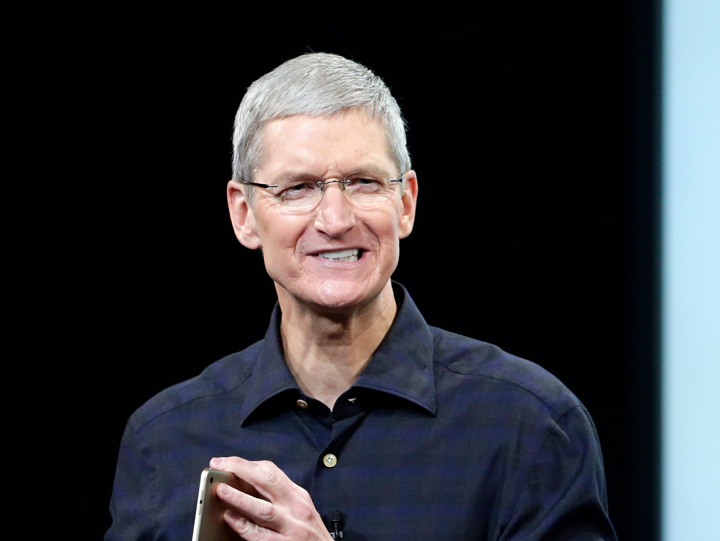 Apple CEO Tim Cook introduces the new Apple iPad Air 2 during an event at Apple headquarters on Oct. 16, 2014, in Cupertino, Calif.