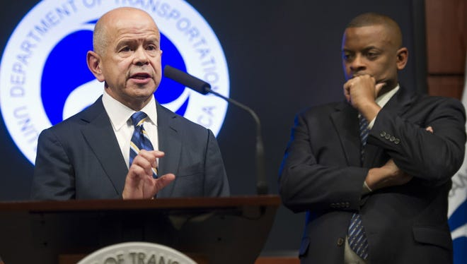 Federal Aviation Administration chief Michael Huerta, left, accompanied by Transportation Secretary Anthony Foxx, speaks during a news conference at the Transportation Department on Nov. 5, 2013. Huerta and Foxx announced new a new safety program for airlines Wednesday.