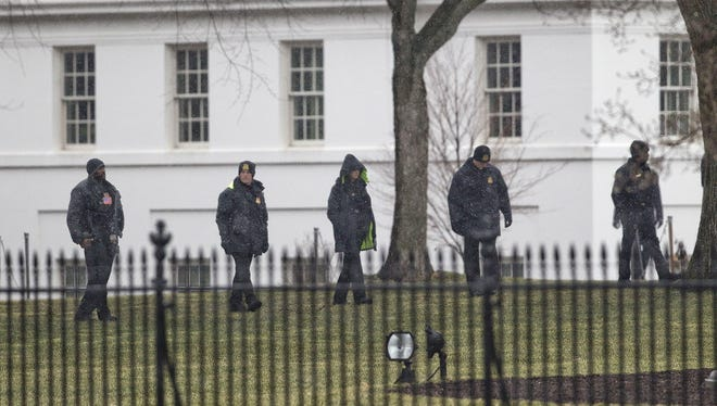 Members of the Secret Service search the grounds of the North Lawn of the White House after a drone crashed on the grounds Jan. 26.