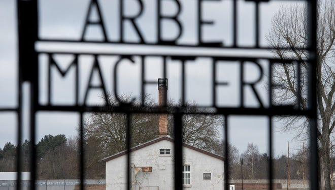 In this March 5, 2015 file picture the writing ' Arbeit macht frei' (work sets you free ) is photographed at the entrance of the memorial of former Nazi concentration camp Sachsenhausen, near Oranienburg, eastern Germany. Google's Niantic Labs  has apologized for making Nazi concentration camps part of a mobile role-playing game.