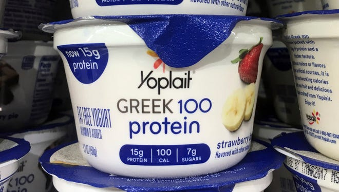 This Thursday, Feb. 23, 2017, file photo shows Yoplait Greek yogurt on display at a supermarket in Port Chester, N.Y. On Tuesday, March 21, 2017, General Mills Inc. reported another sales decline as it faces more competitive pricing and a market that has been shifting demand from processed foods.