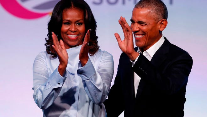 Barack Obama and wife Michelle arrive at the Obama Foundation Summit in Chicago on Oct. 31, 2017.