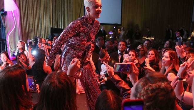 Katy Perry performs during Byron Allen's Oscar Gala Viewing Party to Support The Children's Hospital Los Angeles at the Beverly Wilshire Four Seasons Hotel on March 4 in Beverly Hills. Candy Domengeaux, pictured to the right of Katy Perry, enjoys the concert after a mind-blowing weekend in Hollywood.