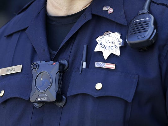 Officer Joe Juarez wears a body camera outside AT&T Park in San Francisco. San Francisco is one of five departments among those in the 20 biggest U.S. cities with rules requiring the cameras for uniformed officers working outside their regular hours.