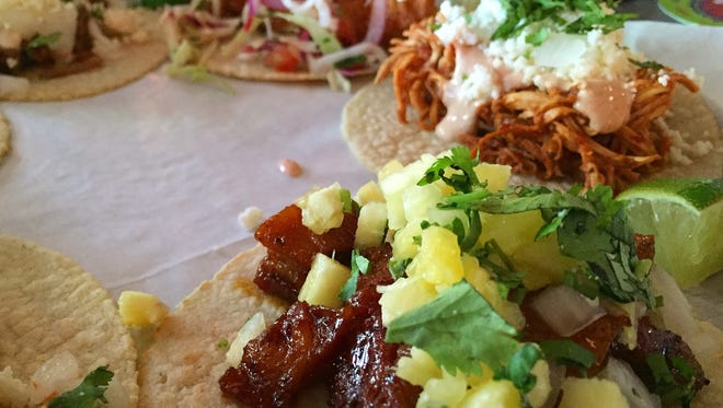 A variety of tacos line a serving tray at Bakersfield on Mass Ave.