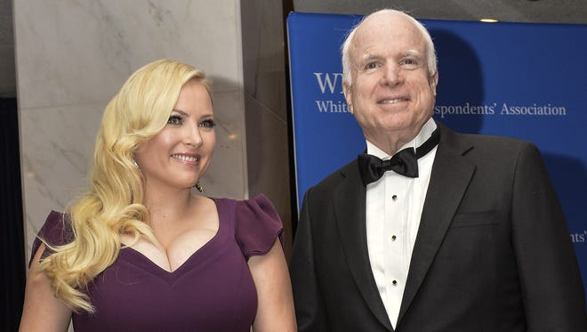 US Republican Senator from Arizona John McCain and daughter Meghan McCain arrive at the White House Correspondents' Association (WHCA) annual dinner in Washington on May 3, 2014.    AFP PHOTO/Nicholas KAMMNICHOLAS KAMM/AFP/Getty Images ORG XMIT: 488380353 ORIG FILE ID: 529465464