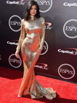 She (literally) sparkled in a gold, metallic Shady Zeineldine gown at the 2015 The ESPYs.