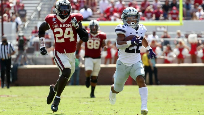 Running back Deuce Vaughn (22) was a breakout star as a freshman for Kansas State in 2021. The Wildcats open their season Sept. 4 against Stanford in Arlington, Texas.