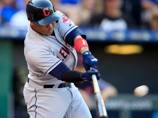 Cleveland Indians' Jose Ramirez hits an RBI double off Kansas City Royals starting pitcher Jason Vargas during the first inning of a baseball game at Kauffman Stadium in Kansas City, Mo., Saturday, Aug. 19, 2017. (AP Photo/Orlin Wagner)