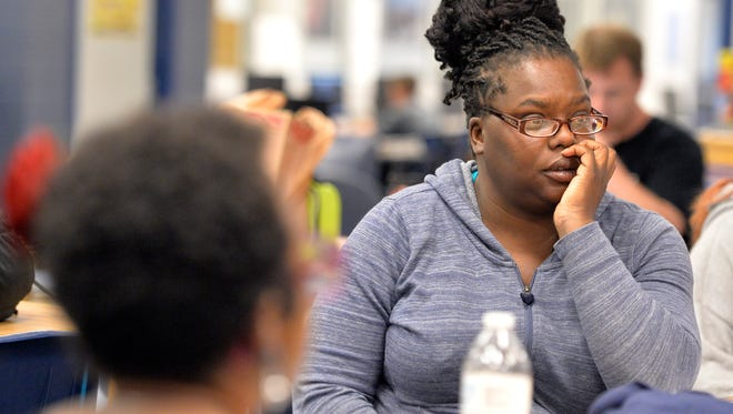 Hannah Drake, a poet from Roots and Wings, listens to the student authors as they practice for their anti-bullying poetry-drama at Moore High School, Friday, Apr. 15, 2016 in Louisville Ky. The Canon, a student literary magazine will be holding the presentation in the Moore High School Theatre on May 5th. (Timothy D. Easley/Special to the C-J)(Timothy D. Easley/Special to the C-J)