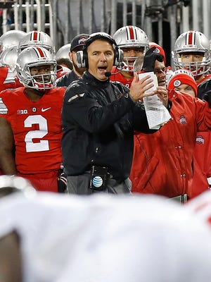 Ohio State coach Urban Meyer signals from the sideline during the third quarter of the Buckeyes' 17-14 loss to  Michigan State  at Ohio Stadium on Saturday.