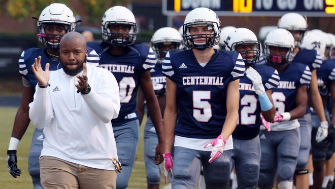 The Centennial football team heads out onto the field before its game against Brentwood at Centennial High School on Oct. 14, 2016.
